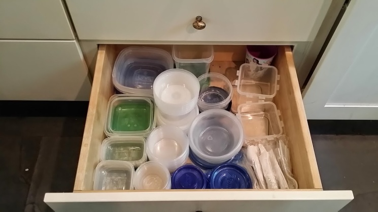 How to Organize Tupperware and Containers - organized small container drawer