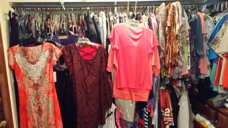 Pairing Down Clothes - hanging closet full of off season clothing