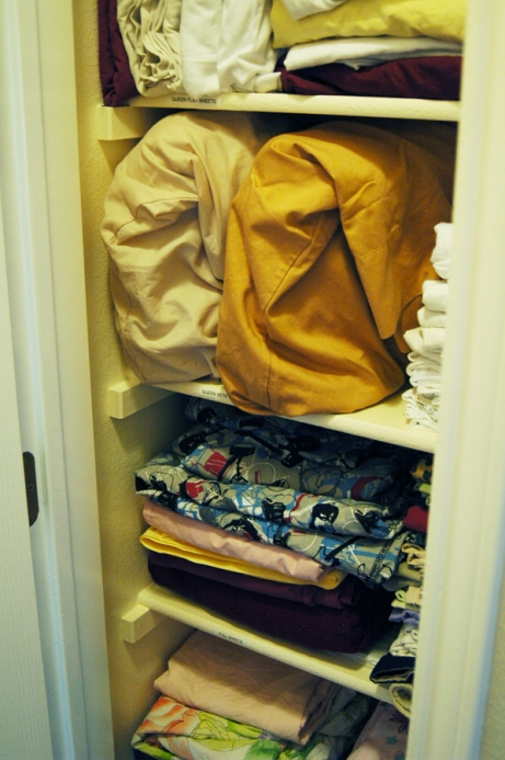 Stuffed Linen Closet - Organized Shelves in Linen Closet