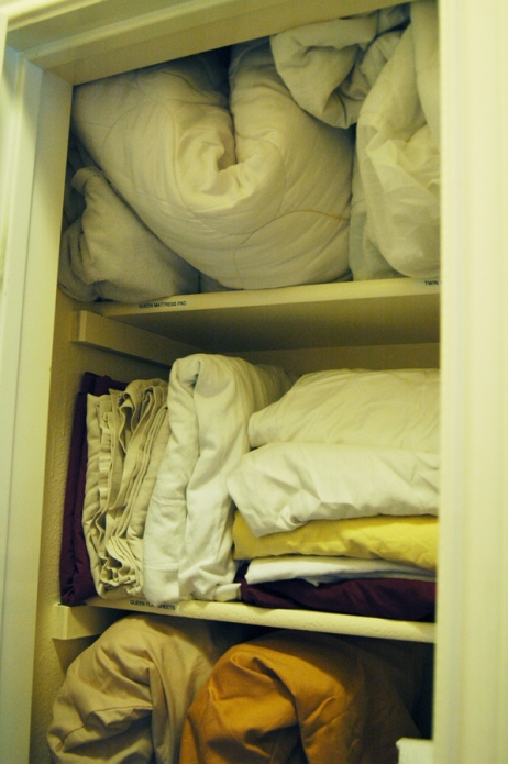Stuffed Linen Closet - Organized Top of Linen Closet
