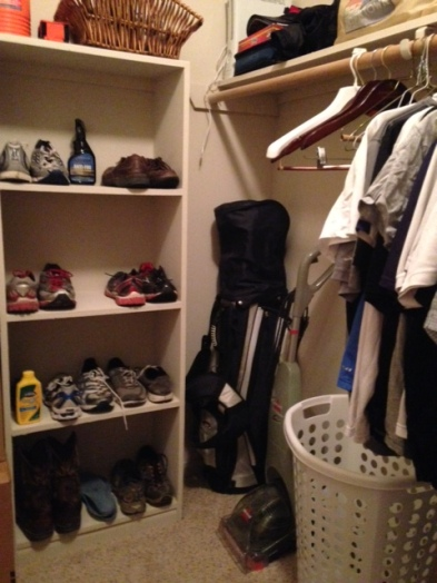 organized clothing closet corner