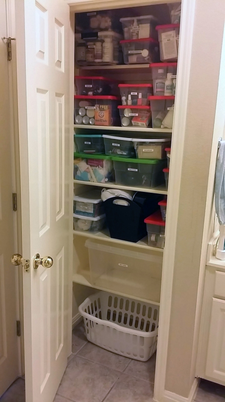 Organizing and Containing Bathroom Closet Items -  Organized Bathroom Closet Full